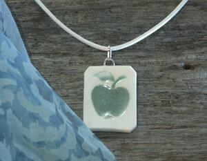 porslinssmycke äpple